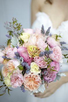 Lavender, Blooming Jasmine, & Pastel shade of garden roses  & ranunculus  www.seedfloral.com