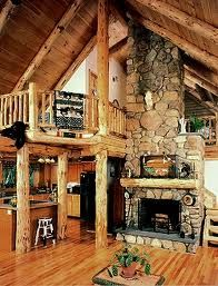 Log cabin with stone fireplace.