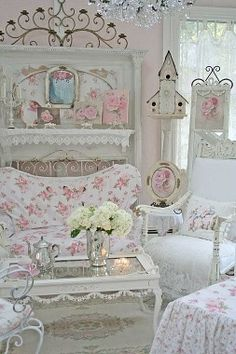 Interesting mix of shabby chic furniture and decor. Love this coffee table and the birdhouse!