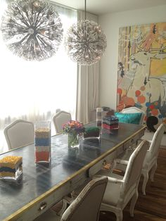 those light fixtures of course, but also the table decor. what about some sort of silver foil decor and vases filled with dyed rice or even cheerios!