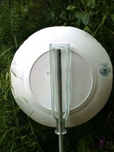 How to make garden plate flowers using bottle on back of plate for use on rebar.