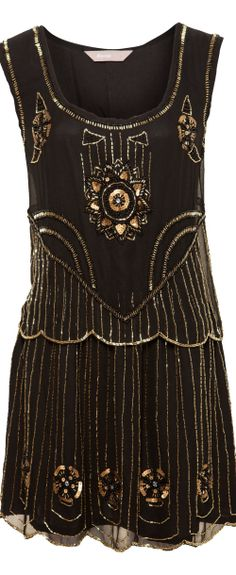 """Black beaded flapper dress - click to read """"The 6 Trends of Christmas"""" at http://boomerinas.com/2013/11/19/the-6-trends-of-christmas-my-favorite-holiday-clothing-styles-2013/"""