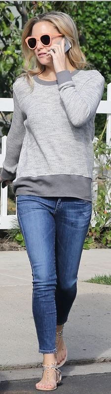 Who made Kate Hudson's gray long sleeve top, peach cat sunglasses, and blue skinny jeans?