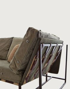 Composed of steel welded frames with a marbled brown finish, custom webbing belts, smooth leather straps and repurposed WWII military fabric. The design is simple, comfortable, and conducive to conversation.  30h × 35d × 102w  $5,000