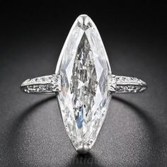 Cartier 3.98 Carat Marquise Art Deco Diamond Ring - A sparkling and streamlined, early twentieth-century vintage marquise diamond, weighing just two points shy of four carats and measuring 7/8 inch long (!) is presented in an elegantly understated platinum and diamond mounting - circa 1920s-1930s - by none other than Cartier . A gorgeous and glorious knock-out Art Deco diamond ring. Signed and numbered.