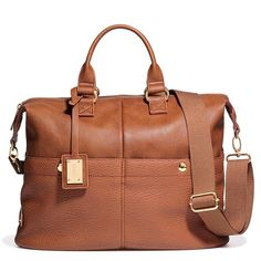 """Trend: Oversize Top-Handle Bag• 100% faux leather (polyurethane)• Zippered top closure• 3 exterior pockets (2 slip pockets at front; 1 zippered pocket at back); 3 interior pockets (2 slip pockets at front; 1 zipered pocket at back)• 15"""" W x 12"""" H x 7"""" D (5 1/2"""" top handle drop, 45"""" max. adjustable, detachable strap)"""