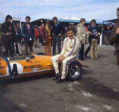 Bruce McLaren , McLaren-Ford M14A before the start of the Race of Champions at Brands Hatch in Kent 1970.