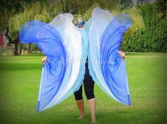 """These flags are a triple layer pair (2 flags) of WATER organza angel wings. Each layer is nested; the largest organza panel is approximately 54"""" x 54"""" and the smallest panel is 52"""" x 52"""". The outer edge is rounded, but it is not a half circle. A 36"""" flagpole is sewn into reinforced handles. The flagpole is ½"""" diameter. WATER = living water (John7.38), cleansing (John13.10), baptism (Ro6.3), river (Ez47.4-5), playfulness Organza is a sheer, light weight fabric. It is great"""