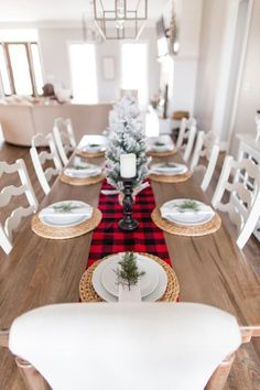 a very simple and cozy winter table with a plaid runner, woven palcemats, evergreens and a snowy Christmas tree - DigsDigs Farmhouse Christmas Decor, Christmas Kitchen, Rustic Christmas, Christmas Home, Christmas Ideas, Purple Christmas, Coastal Christmas, Christmas Crafts, Plaid Christmas