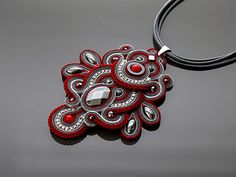 Beautiful, impressive soutache necklace, made of soutache strings with Hematite and glass beads.  Pendant have been impregnated.  Full length: 4 inches.  Length of string: 18 inches  Colour: dark red, silver and graphite.    Black friday weekend  Sale 20%  Use code BLACK20 ( during checkout )   * code expires Monday, 28th