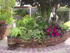 Spiral+Brick+Raised+Vegetable+Beds | raised tudor brick flower beds