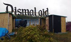 Makeshift huts have started to spring up in 'Dismalaid' using timber from Banksy's 'bemusement park' which closed last month.