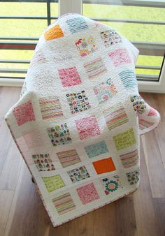 This quilt will be made to order, so please allow 1-3 weeks to be ready to ship after purchase.  This modern baby quilt is good for both boy