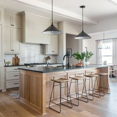 Revere Pewter Kitchen Cabinets, White Oak Island, black countertops and marble backsplash. White Oak Kitchen, White Kitchen Cabinets, New Kitchen, Kitchen Dining, Kitchen Decor, Kitchen Modern, Kitchen Layout, Cream And Oak Kitchen, Natural Wood Kitchen Cabinets