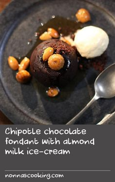 """Chipotle chocolate fondant with almond milk ice-cream   """"With the flavours of Spain and the passion of flamenco, this chocolate dessert ticks all the boxes for me. The cakes should be just cooked on the outside and starting to pull away from the sides of the moulds, while the centres should be soft and molten. Because all ovens vary so much in temperature, if you can, bake one to check the timing before baking the rest. This is a great dessert for entertaining because everything can be…"""