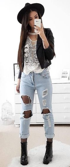 #winter #outfits black leather jacket, white inner top and distress blue jeans with boots outfit