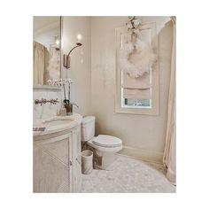 christmas is finally all packed up! @worldsaway1 @gabbydecor @kohlerco @lowcountry_originals_atl @candiceolsondesign #featherwreath #cantforgetthepowderroom #whitechristmas #marble #bathroom #powderroom #interiordesign