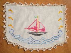 Vintage Sailboat and Gold Fish hand embroidered on Oyster Linen.  Perfect for chair back or vanity table - or frame it to hang in your nautical themed room!