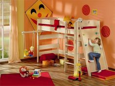 Turn a loft bed into an indoor playroom? I'd make the underside a reading nook.  Like the bar for a swing but I wonder how you reinforce it to hold the weight?  Love the rock wall for when the LOs are restless!