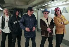The band and Jimmy Fallon put on disguises to give a surprise performance in NYC's 42nd St. subway station.