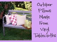 Outdoor pillows made from vinyl tableclothes.