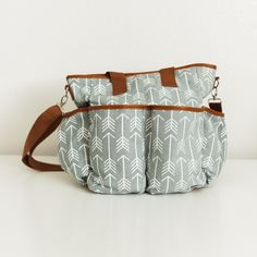 THIS PRE SALE ITEM WILL SHIP OUT THE FIRST WEEK OF OCTOBER The arrows diaper bag…