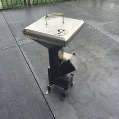 Stainless steel rocket stove accessory, grill top grate and reducer *stove sold separately* Rocket Stove Design, High Heat Paint, Expanded Metal Mesh, Metal Plant Hangers, Stove Accessories, Concrete Block Walls, Stainless Steel Rod, Custom Vanity, Rocket Stoves