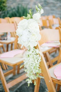 Wooden garden chairs and white floral detailing are lovely in an outdoor environment + The Main Event Cabo