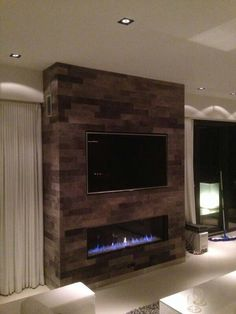 Fireplace and TV Wall in leather. 8 don't like the color nor the fabric. I'm more into the dark gray slate stones.  But I love the shapes. And I love how perfectly the TV fits