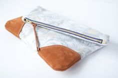 pretty fold over zip clutch    *made with a metal zip and suede corners...fully lined with grey duck cloth. I could DO this...