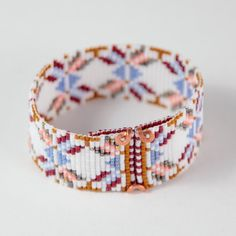 This Native Bows Bead Loom bracelet was inspired by the rich and beautiful Southwestern heritage that surrounds me here in Albuquerque, New Mexico. As with all my pieces, Ive created it on a bead loom with great care and attention to detail. IMPORTANT NOTE: This bracelet measures approximately 6 3/4 long. Please measure your wrist carefully before order placement, to ensure a proper fit. If 6 3/4 is not the correct size for you, please contact me for options.  The beads used in this...