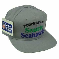 """HAT CAP SNAPBACK VINTAGE SEATTLE SEAHAWKS NEW ERA FLAT BILL DEADSTOCK OLD SCHOOL by New Era. $34.95. Official Licensed Product. Snap Back. 30% Wool 70% Acrylic. Brand New Item with Tags. Adjustable. This is NOT a 2010-2011 Replica. This is an extremely rare, unworn, authentic DEADSTOCK vintage snapback with original tags. Made in the early 90's. Our entire vintage collection is 100% authentic. We do not stock reproductions. Flat bill. Green underbrim. """"Property ..."""