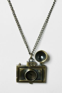 Camera Clock Pendant necklace from Urban Outfitters.  #jewelry
