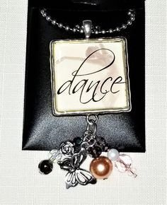 """Necklace Pendant with a Main Focal """"DANCE"""" and Assorted Drops of Faceted Glass and Pearls Lace Heart, Upcycled Crafts, Faceted Glass, Ball Chain, Craft Items, Pearl White, Craft Projects, Dangles, Pendants"""