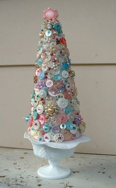 This is so durn cute!  Buttons pinned on styrofoam tree.