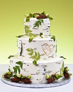 2. Birch Wood Rustic Wedding Cake…    Photo CreditBirch wood is a big trend in many rustic weddings with centerpieces, invitations, ring pillows, and favors centered around this…