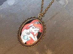 This Listing is for a cute, antique Bronze necklace with the last Unicorn  under a glass Dome. The image comes in a Victorian Setting. The lenght of this necklace is customizable and it will arrieve y