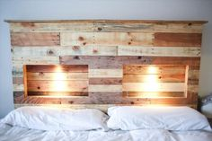 DIY Pallet Headboard | Pallet Furniture Plans. Love the spaces for lights. Maybe could do this with a DIY fabric headboard