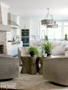 Comfy cowhide-covered swivel chairs fill the sitting space off the kitchen.