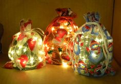 "I took some Christmas Bags and lit them up with battery-operated fairy lights on a timer. These are 5"" by 7"" decorative bags lit with my 18 fairy light LEDs on 3-foot coated copper wire."