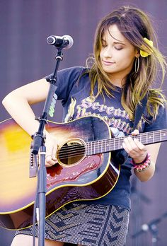 Kacey Musgraves - I LOVE Kacey and I love her western inspired style! This skirt/graphic tee combo is adorable.