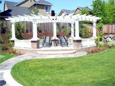 Curved arbor and raised seating area.  By Veranda Landscaping