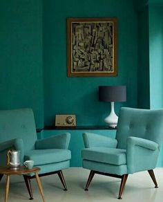 Mid-century living room with cubist abstract painting, perfectly offset by teal walls.