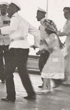 Anastasia dancing with officers onboard the Polar Star, 1913