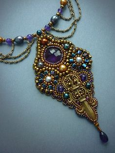 Shining weapon - necklace with amethyst. $209.00, via Etsy.