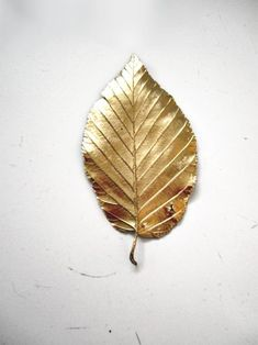DIY golden painted leaf. Sums up this spring/summers cherished gold trend, bringing warmth and creativity using a natural material.