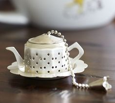 Teapot Tea Infuser. Cute but please, only for decoration. Too small for tea leaves to properly unfurl.