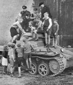German kids pose for a photo on a Panzer I. Germany, date unknown.