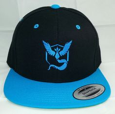 Pokemon GO Team Mystic Embroidered Snapback Baseball Hat / Black w/ Teal Bill Hat  Classic Yupoong Snapback Cap by HATQUARTERS on Etsy https://www.etsy.com/listing/466960977/pokemon-go-team-mystic-embroidered