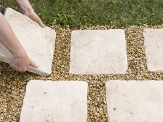 Pavers set in gravel to take care of muddy walkway from driveway to front door. Add metal edging between gravel and lawn.